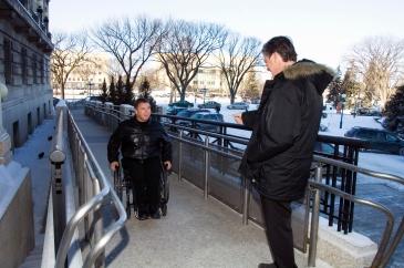 Rick Hansen greets former Manitoba Premier Gary Doer